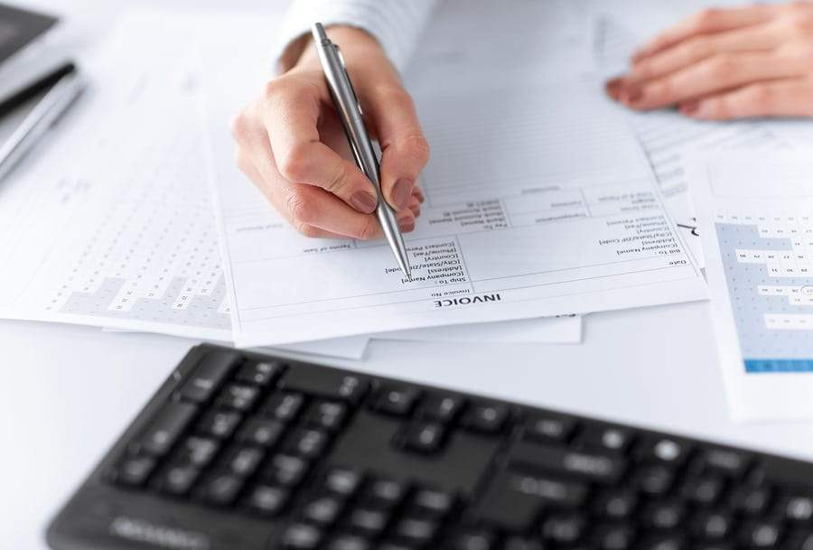 picture of a woman filling out a credit policy form invoice
