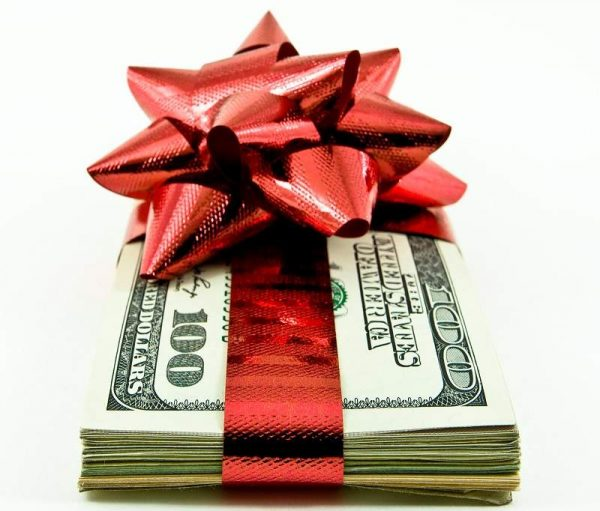 money wrapped in a ribbon